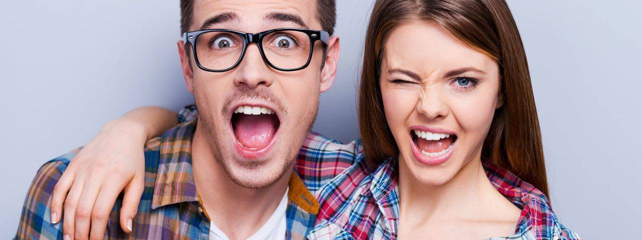 glasses american couple winking 1280x480